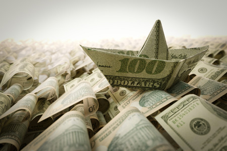 shallop: Ship from dollar paper in the money sea concept composition photo