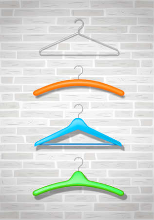 hangers: Hangers for clothes of different colors on the old brick wall