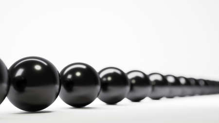 3d illustration. A row of black balls. Depth of field. Abstract composition