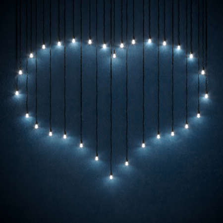 3d illustration. Heart shaped lamp garlands on the wall. Blue romantic background. Night