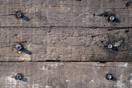 Old wooden boards with bolts, background. 写真素材