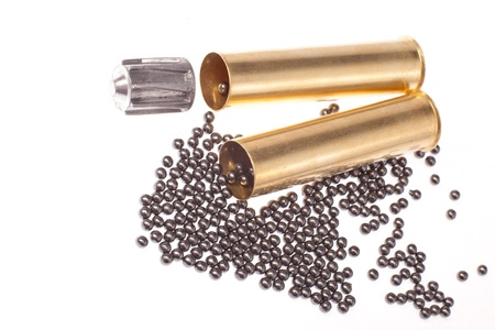bullet, buckshot and brass shell casings on a white background photo