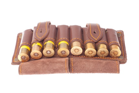 bandolier with hunting cartridges on a white background photo