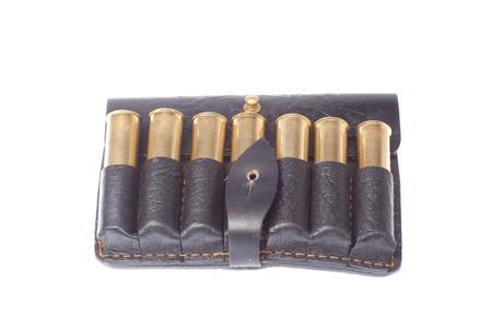 hunting cartridges in black leather potrantashe on a white background photo