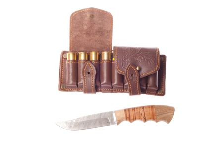Knife with ammunition for hunting on a white background photo