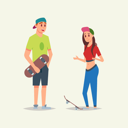 Young and sportsmanlike skaters boy and girl speaking and holding skateboards Stock fotó