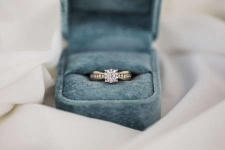 Gold wedding rings in box. Ring with diamonds