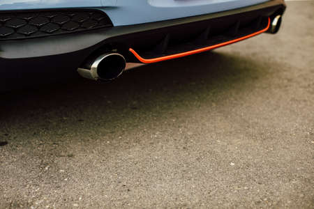 Modern Vehicle Sport Exhaust System. Exhaust End Closeup Photo. sports car