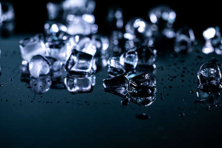 ice cubes reflection on black background. close up