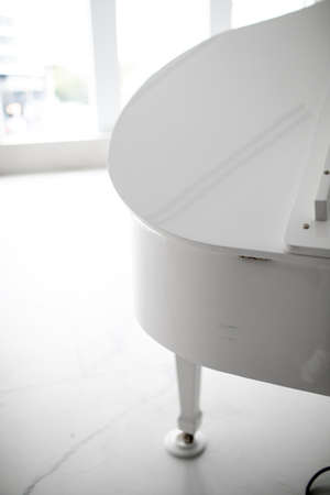 white grand piano on a white background. play music