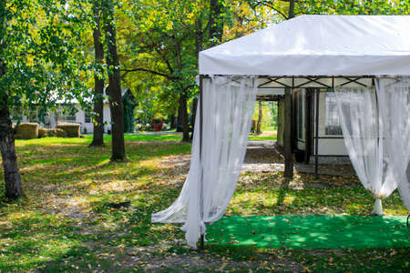tent with haze peachy fabric and floral decorations Stock Photo