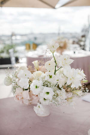 Wedding , festive decor. Bouquet from spring flowers. Table layout. Table of newly married. Restaurant interior