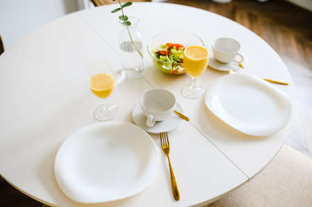 Table served for breakfast in living room, close up view.