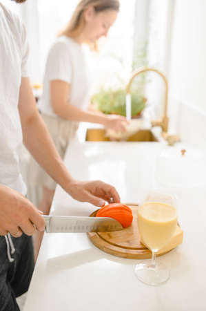 young family cooks in a bright kitchen