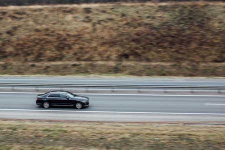 black Executive car in motion. luxury car, business concept.