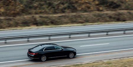 black Executive car in motion. luxury car, business concept Stok Fotoğraf