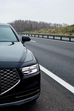 Headlight of a modern car. Black car Stok Fotoğraf