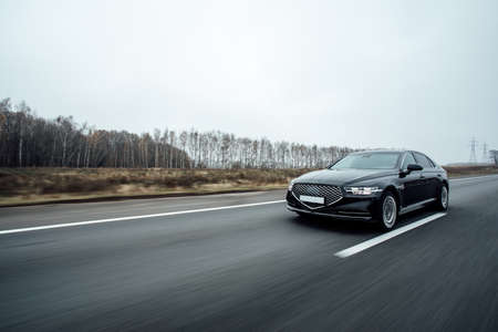 black Executive car in motion. luxury car, business concept Фото со стока
