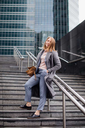 young girl in a business suit on the stairs. Stok Fotoğraf