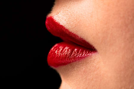 Close-up perfect red lip makeup beautiful female mouth. Plump sexy full lips. Macro photo face detail