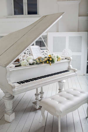 White piano in white room. play music Stock Photo