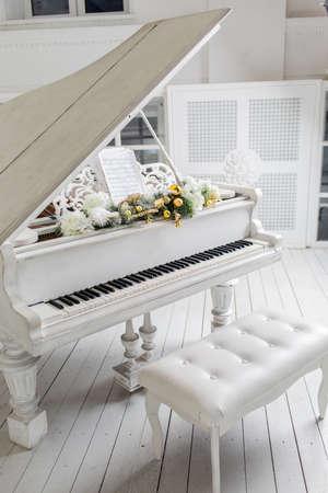 white piano in a white interior. Luxury interior