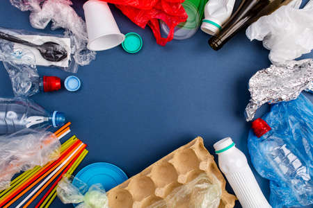 Samples of trash that can be recycled isolated on blue background. Copy space.