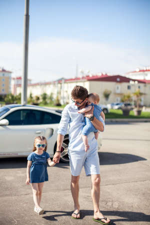 young father and daughters outdoor. Happy family.