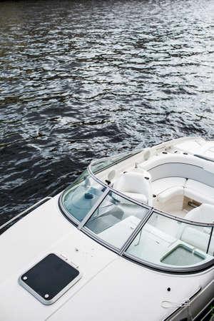 Pleasure boat. White tone. Steering wheel.
