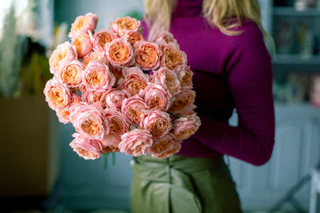 Large beautiful bouquet of mixed flowers in woman hand. Floral shop concept . Handsome fresh bouquet. Flowers delivery