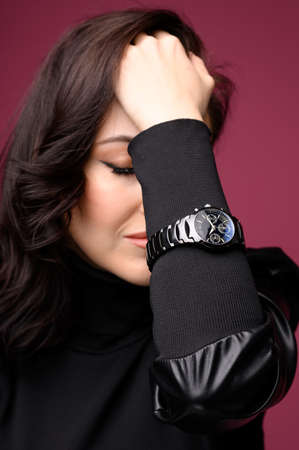 Beautiful woman middle age wearing black watch. Wrist shot