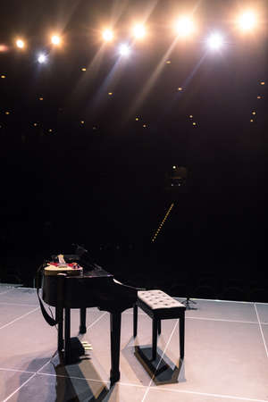 black piano on stage. grand piano on the stage before the performance.
