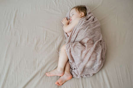 cute infant baby girl sleeping in bed. top view Stock Photo