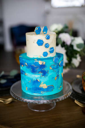 Closeup of white and blue wedding cake. white milk cream