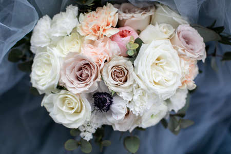 Wedding bouquet of pastel flowers, vintage style, blurred background