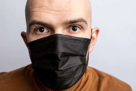 cancer patient in medical mask. Flu illness young man in medicine healthcare mask