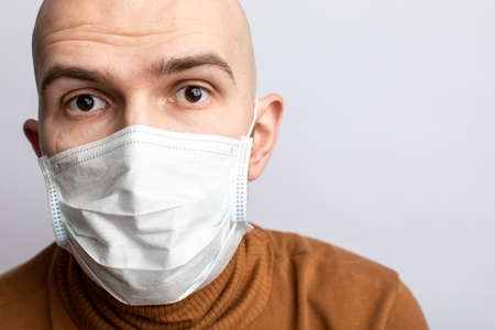 a man in a medical mask. Protection from coronavirus. white background