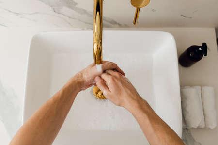Washing hands rubbing with soap man for coronavirus prevention, hygiene to stop spreading coronavirus Standard-Bild