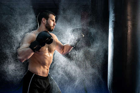 Sportsman boxer fighting on black background with smoke. Boxing sport concept. Shadow fight 版權商用圖片