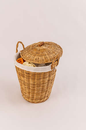 wicker basket for dirty laundry white background isolated