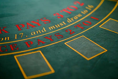 playing roulette at the table in the casino. Top view at a roulette green table with a tape measure. Archivio Fotografico