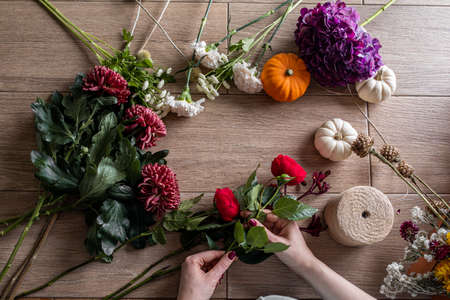 Female florist holding beautiful bouquet at flower shop