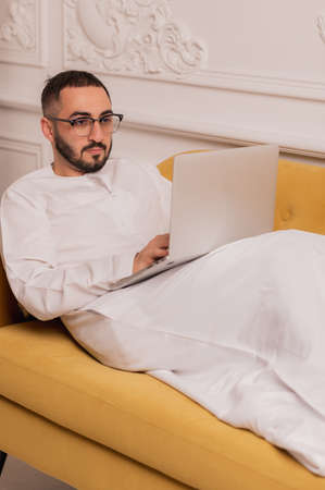 Arab businessman working on laptop computer at home Stock Photo