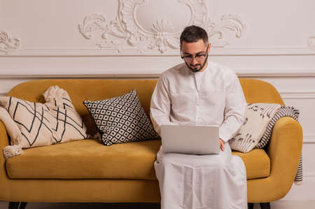 Arab businessman working on laptop computer at home Banco de Imagens