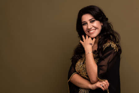 Portrait of beautiful smiling young muslim arabian woman looking at camera, copy space Reklamní fotografie