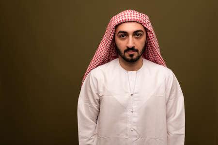 Muslim man. Portrait of a young arab man in traditional dress. Reklamní fotografie