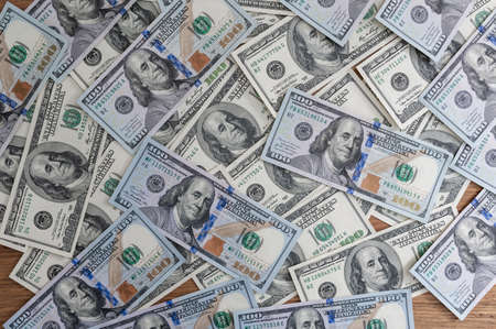 One Hundred Dollar Banknotes background. Dollars Closeup Concept Stock Photo