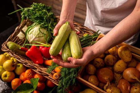 Organic vegetables. Farmers hands with freshly picked apples. Fresh organic apples. Fruits and vegetables market Banco de Imagens