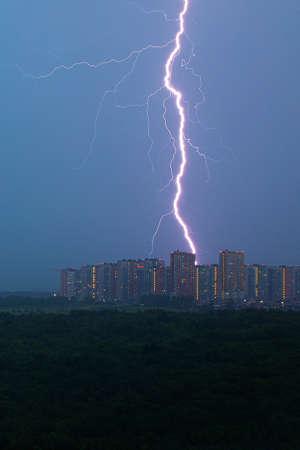 lightning strikes the city. Lightning strike at home