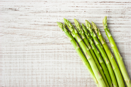 sprigs: Sprigs of asparagus  at the right of the  table Stock Photo